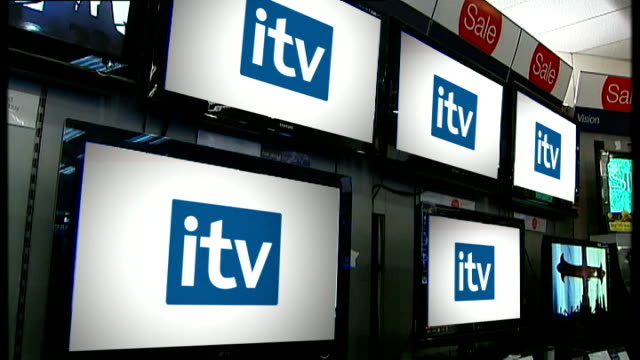 vídeos y material grabado en eventos de stock de itv channel 4 and channel 5 merger suggestion graphicised pictures televisions on display in electrical store with channel 4 channel 5 and itv logos... - teleprompter