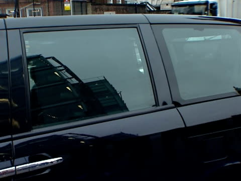 channel 4 board members arrive at channel 4 headquarters black taxi cab arrives / black car arrives as channel 4 employee out of car / channel 4... - fare video stock e b–roll