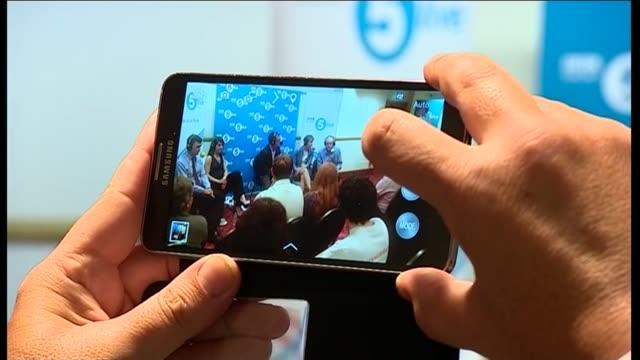 look at leadership race lib hertfordshire stevenage phone screen taking photo of labour leadership candidate radio 5 hustings cooper speaking at... - stevenage stock videos and b-roll footage