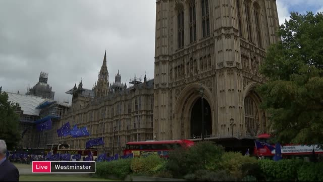 channel 4 news noon pab; england: london: westminster: ext tilt down victoria tower reporter to camera - jon snow journalist stock-videos und b-roll-filmmaterial