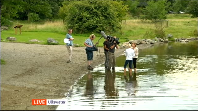 channel 4 news pop up series lake district england cumbria lake district ullswater ext gina campbell interview on her father donald campbell and the... - channel 4 news stock videos and b-roll footage