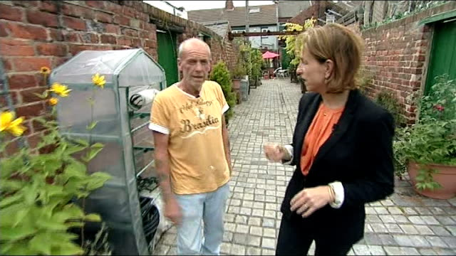 vídeos de stock, filmes e b-roll de channel 4 news 'pop up' series middlesbrough england middlesbrough ext flower hanging baskets and outdoor tables and chairs in transformed alley... - channel 4 news