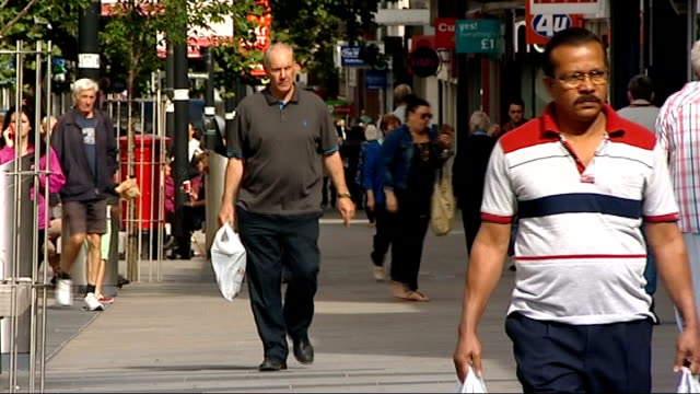 channel 4 news 'pop up' series swindon england wiltshire swindon ext reporter to camera shoppers along pedestrianised high street vox pops 'to let'... - channel 4 news stock videos and b-roll footage