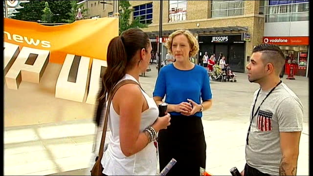 channel 4 news 'pop up' series swindon vox pops shoppers along past some boarded up / closed down shops channel 4 news 'pop up' banner in high street... - channel 4 news stock videos and b-roll footage
