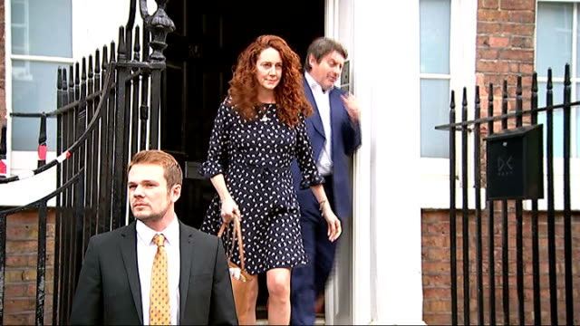 channel 4 news review of the year r26061415 / rebekeh brooks and husband charlie brooks departing house and statement to press sot old bailey andy... - channel 4 news stock videos and b-roll footage