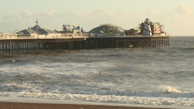 channel 4 news special: coronavirus: is britain ready?; england: east sussex: brighton: ext general views brighton pier and beach - report produced segment stock videos & royalty-free footage