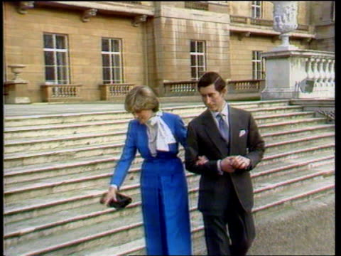 Channel 4 News Special on the death of Diana Princess of Wales LIB London Buckingham Palace Prince of Wales and Diana down steps arm in arm and pose...