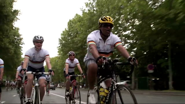 channel 4 news team complete sponsored bike ride to raise money for duchenne children's trust france paris ext krishnan gurumurthy speaking to camera... - krishnan guru murthy stock videos & royalty-free footage