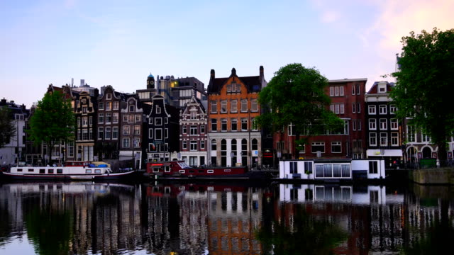 channel in downtown amsterdam netherlands at twilight - canal stock videos & royalty-free footage