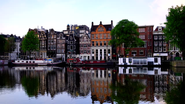 channel in downtown amsterdam netherlands at twilight - amsterdam stock videos & royalty-free footage