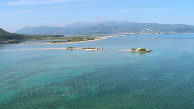 WS AERIAL Channel of Lefkada and lagune with Ocean and mountain / Lefkada, Ionian Islands, Greece