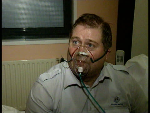 stockvideo's en b-roll-footage met channel tunnel fire; itn france: calais int lms mick terry sitting with oxygen mask on tilt up to oxygen bag cms mick terry intvwd sot - talks about... - dawn french