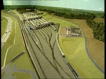 channel tunnel opening:; a)nat: england: kent: folkestone: int tcs model of channel tunnel project working tcms ditto tcs ditto ? ext lams train... - eurotunnel folkestone stock-videos und b-roll-filmmaterial