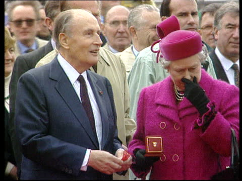 bnat england kent folkestone francois mitterrand and elizabeth ii chatting after cutting channel tunnel ribbon cms queen hands mitterrand... - the alphabet stock videos & royalty-free footage