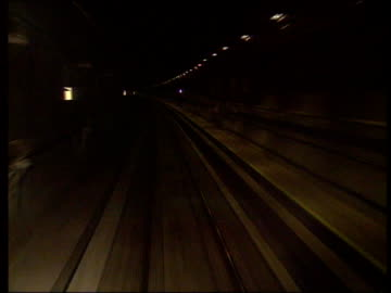 channel tunnel opening:; underground gv tunnel seen from front of train track forward man getting out of car as it rides on le shuttle france: ext gv... - eurotunnel folkestone stock-videos und b-roll-filmmaterial