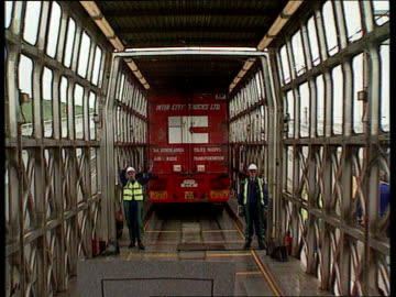 channel tunnel opens to freight traffic; england: lorry along road track forward int lorry cms man driving in his cab road seen thru windscreen ext... - eurotunnel folkestone stock-videos und b-roll-filmmaterial