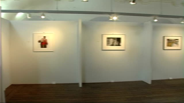 photography exhibition general view of framed photographs on wall in exhibition room geordie storey interview sot - kettenglied stock-videos und b-roll-filmmaterial