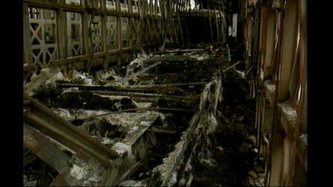 channel tunnel remains closed after fire; lib t21119602 france: calais eurotunnel terminal: ext fire damaged freight wagons various of debris of... - eurotunnel folkestone stock-videos und b-roll-filmmaterial