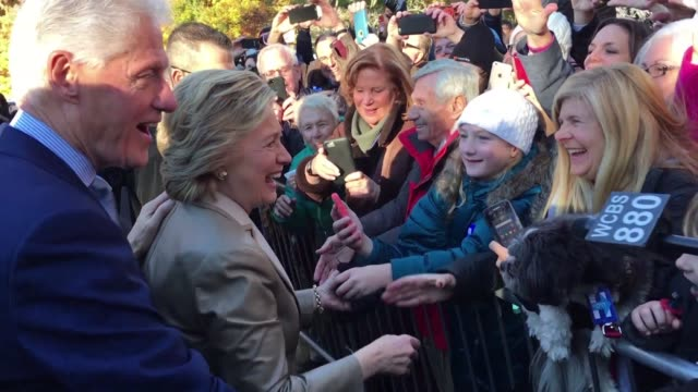 chanting madam president about 150 supporters turned out to cheer on the democratic nominee hillary clinton who voted with husband bill clinton at an... - bill clinton bildbanksvideor och videomaterial från bakom kulisserna