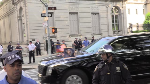 chanting protesters greet donald trump's motorcade as his limousine passes, shouts of 'shame' as it arrives for gop fundraiser at home of cantor... - präsident der usa stock-videos und b-roll-filmmaterial