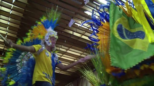 Chants of Nippon break out in a Japanese Brazilian cultural center in Sao Paulo as 300 fans cheer on the Asian team in their World Cup game against...