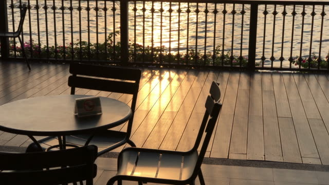chao phraya riverside cafe in twilight moment, bangkok , thailand - patio stock videos & royalty-free footage