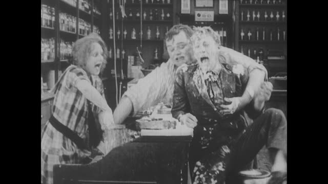 1917 chaos ensues when two men (fatty arbuckle and al st. john) fight over woman (alice mann) - fatty arbuckle stock videos and b-roll footage
