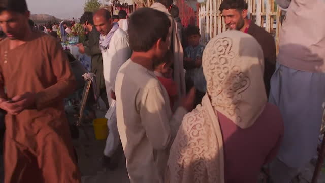 chaos outside kabul airport as afghans try to escape the country after the taliban takeover, taliban try to control the crowds - chaos stock videos & royalty-free footage