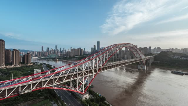 t/l ws ha chaotianmen bridge time lapse against the backdrop of jiefangbei cbd / chongqing, china - raffles city stock videos & royalty-free footage