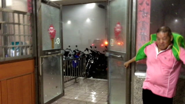 chaotic scene as doors of building smash open in violent wind of super typhoon nepartak as it hit taiwan on 8th july 2016 - taiwan stock videos & royalty-free footage