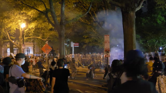 chaotic scene as protesters set off fireworks and move police barricades - barricade stock videos & royalty-free footage