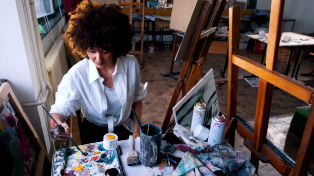 chaotical creative artist in her art studio - painter artist stock videos and b-roll footage
