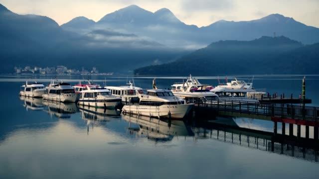 chaowu pier at dawn, sun moon lake, taiwan - sun moon lake stock videos and b-roll footage