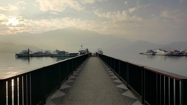 chaowu wharf panning left, sun moon lake, taiwan - wen wu temple stock videos and b-roll footage