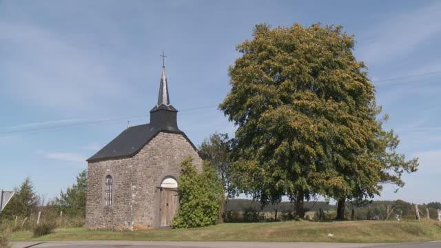 ms chapel along side by road / libin, walloon area, belgium - chapel stock videos & royalty-free footage