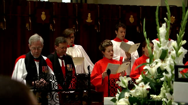 chapel service recreated in memory of wartime bomb attack at wellington barracks england london int **music heard sot** choir singing various of... - choir stock videos & royalty-free footage