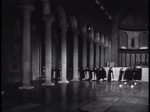chapel w/ order of friars preachers walking into chapel, kneeling in lines, no pews, priest passing line of kneeling friars, slinging holy water,... - theology stock videos & royalty-free footage