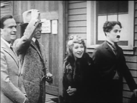 chaplin pickford dw griffith and fairbanks posing talking outdoors / newsreel - film director stock videos and b-roll footage