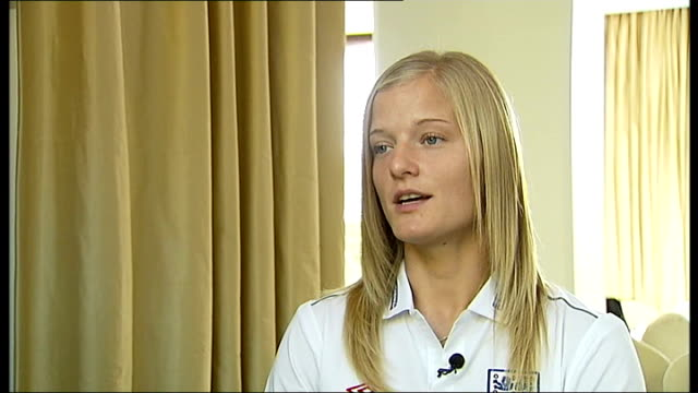 EXT Chapman training with other members of England women's football team Katie Chapman interview SOT Reporter to camera INT Reporter meeting Chelsea...