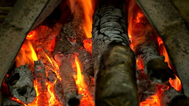 charcoal burning in bbq in the fireplace frame background. - oven stock videos and b-roll footage