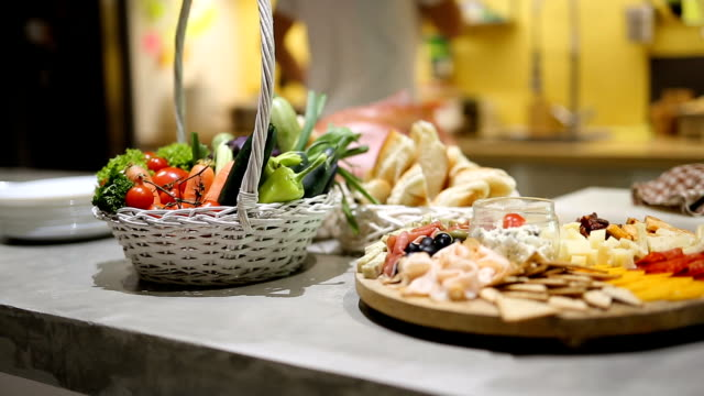 charcuterie board and kitchen staff preparing food - plank variation stock videos & royalty-free footage