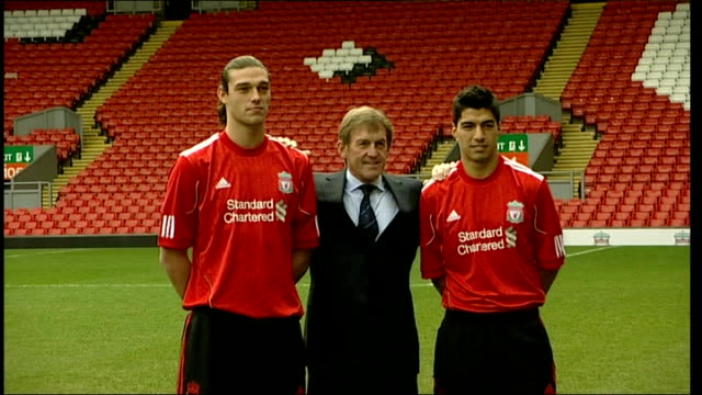 charge luis suarez with violent conduct; lib anfield: luis suarez on pitch for photocall with kenny dalglish and andy carroll at time of signing - liverpool england stock videos & royalty-free footage