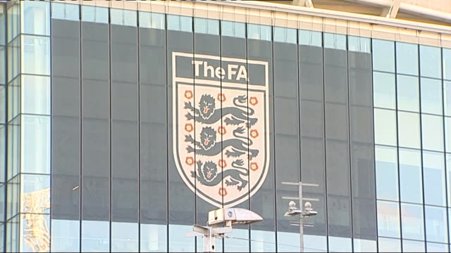 stockvideo's en b-roll-footage met charges joey barton with two acts of alleged violent conduct; r03021214 london: wembley stadium: large 'the fa' sign and logo on side of wembley... - english football association