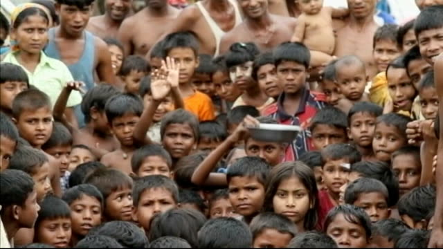 charges of ethnic cleansing attacks on rohingya muslims lib sittwe ext rohingya refugees beside tents at refugee camp mass group of child refugees... - rohingya kultur stock-videos und b-roll-filmmaterial