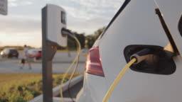 SLO MO Charging a car at charging station on a parking lot