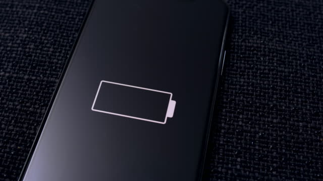 ds charging a smartphone on a black textile surface - lithium ion battery stock videos & royalty-free footage