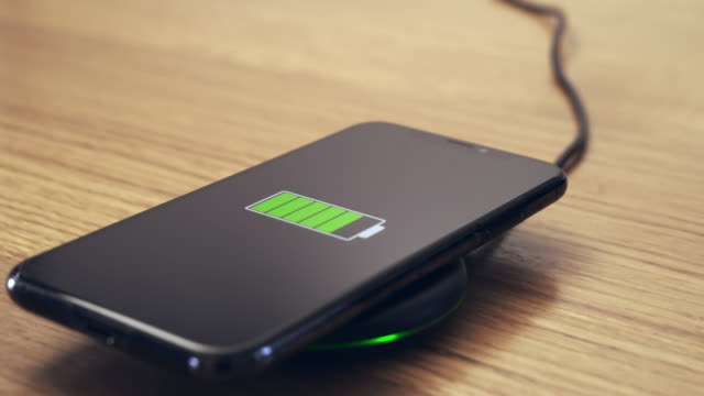 ds charging a smartphone with advanced wireless technology - lithium ion battery stock videos & royalty-free footage