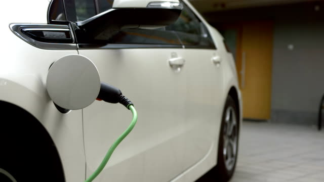 hd: charging an electric car at home - electrical equipment stock videos & royalty-free footage