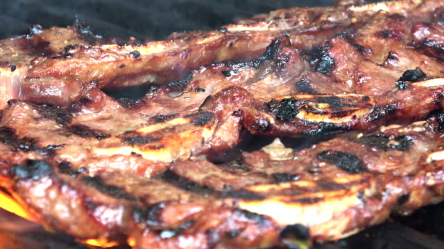 char-grilled barbecue korean short ribs - rib food stock videos and b-roll footage