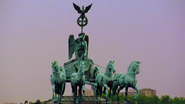 Chariot statue (Quadriga) on top of Brandenburg Gate / Berlin, Germany